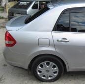 Купить фирменный спойлер на крышку багажника Ниссан Тиида (магаз