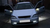 Фирменный накладки на фары Opel Astra G (верхние реснички Астра