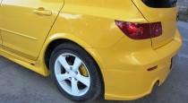 Установка порогов на Mazda 3 5d