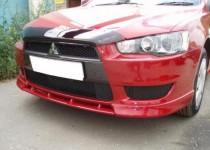 Перемычка между передними клыками на бампер Mitsubishi Lancer X