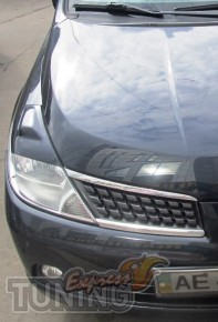 Тюнинг реснички на фары Nissan Tiida (фото, ExpressTuning)