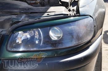 Передние реснички на фары Опель Омега Б (фото, ExpressTuning)