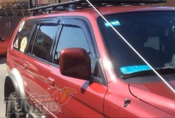 ветровики Mitsubishi Pajero Sport 1)