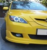 Тюнинг реснички на фары Mazda 3 в кузове Хэчтбек