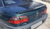 Установка заднего спойлера на багажник Опель Омега Б (фото, Expr