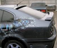 Накладка спойлер на заднее стекло Шкода Октавия А4 тур (фото коз