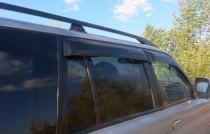 Ветровики Mitsubishi Pajero Sport 1 (дефлекторы окон )