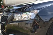 Накладки реснички на фары автомобиля Шевроле Круз в кузове седан